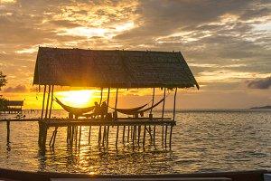 Hammock on Sunset at the Diving Station - Kri Island. Raja Ampat, Indonesia, West Papua