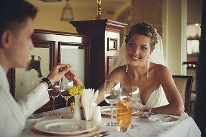 Stunning bride holds groom's hand