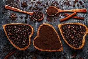 Top view of coffee beans, ground coffee and spices.