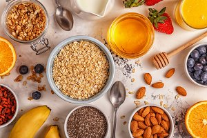 Ingredients for a healthy breakfast -  oatmeal, granola, honey,