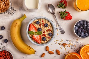 Healthy breakfast - a bowl of oatmeal, berries and fruit