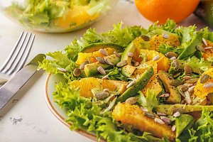 Avocado orange salad with  pumpkin  and sunflower seeds.