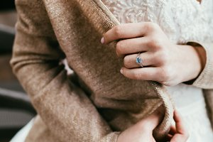 Bride dress on sweater to get warm