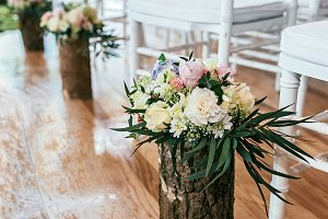Wedding bouquet in timber vase on floor in ceremony place