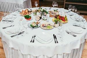 Round restaurant table served luxury for festive dinner