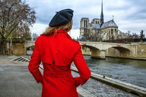 traveller woman looking at Notre Dame de Paris in Paris, France