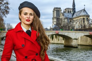 traveller woman standing on embankment in Paris, France