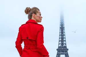 woman against Eiffel tower in Paris looking into distance