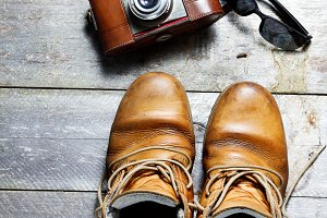 Old boots and vintage camera