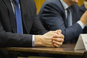 Businessman's hand at conference or meeting, financial concept