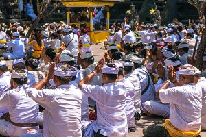 Unidentified Indonesian people go to celebrate Balinese ceremony at Pura Goa Lawah temple, Bali, Indonesia