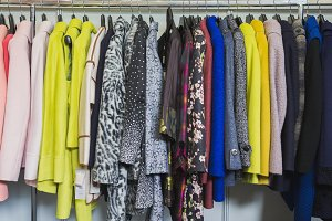 Colourful clothes in clothing store - dresses and jackets