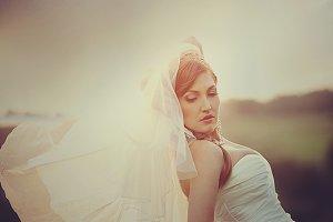 Bride bends over standing