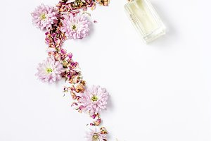 Bottle of perfume with flowers