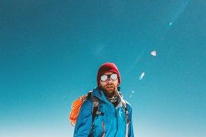 Man alpinist climbing in mountains