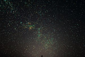 Silhouette of man on a background stars.