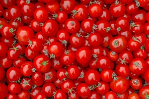 Red tomatoes background. Top view.