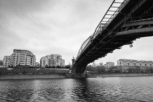 Moscow, Russia - March 02, 2017: View of Rostovskaya naberezhnaya and Bogdan Khmelnitsky foot-bridge