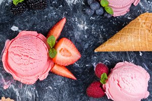 Selection of colorful berry ice cream on marble background