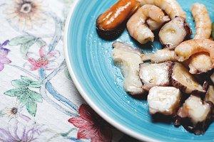 Tasty seafood salad. Horizontal shoot.
