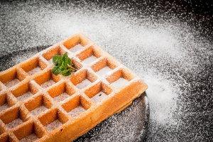 Belgian waffle with powdered sugar
