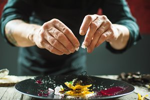 Close-up of male hands preparing molecular dish
