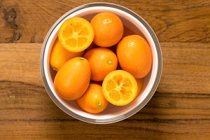 From above view of glass bowl of kumquat fruit
