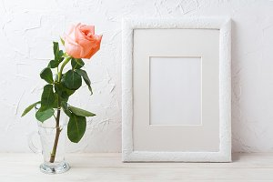 White frame mockup with pink rose