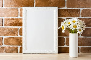 White frame mockup with daisy