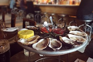 Oysters on ice plate in restaurant