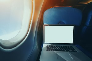 Laptop with blank screen in airplane