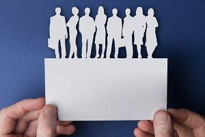 Business teamwork paper cutout sign