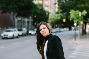 Woman waiting on crossroad