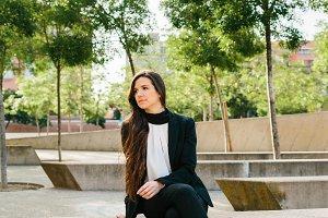 Businesswoman on concrete block
