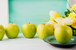 White green pastel background with apples. Healthy food