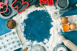 Baking sweets frame on dark blue