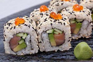 Sushi roll on black plate