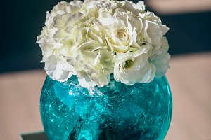 Wedding flowers in emerald glass pot