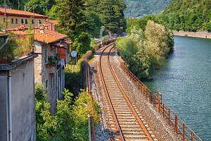 Railroad along river in Italy