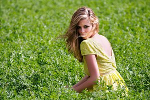 Blonde girl in a meadow