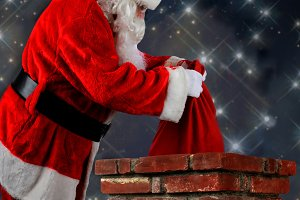 Santa Putting Bag into Chimneys