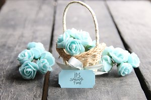 Its spring Time, spring flowers in a small basket on a vintage background