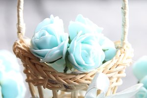 Its spring Time concept, spring flowers in a small basket on a vintage background