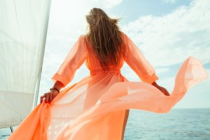 luxury woman yachting in pareo