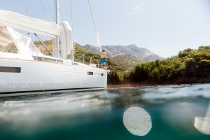 man yachting blue lagoon