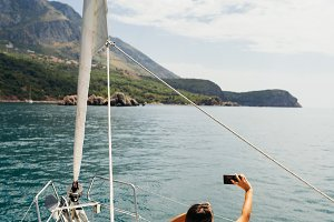 girl yachting with smartphone