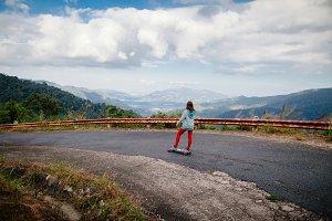 teenage girl with longboard