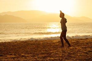 teenage girl slacklining on beach