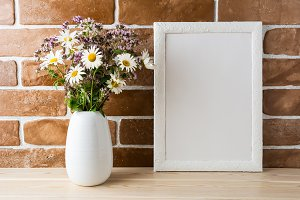 White frame mockup with wildflowers