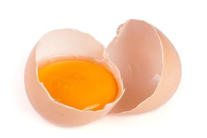 Broken egg with yolk and eggshell isolated on white background